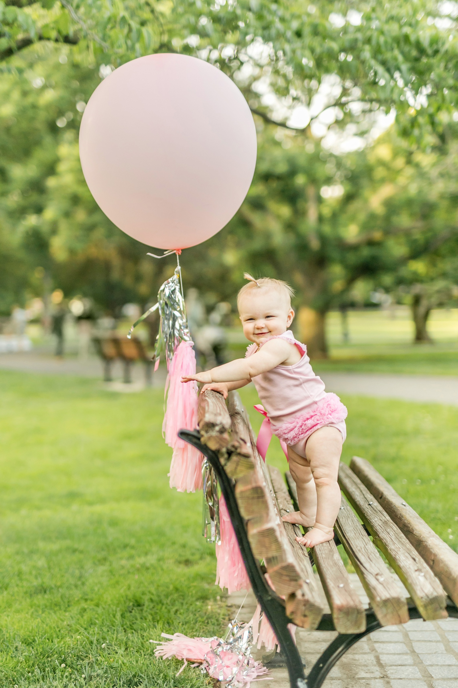 baby with balloon in Public Garden