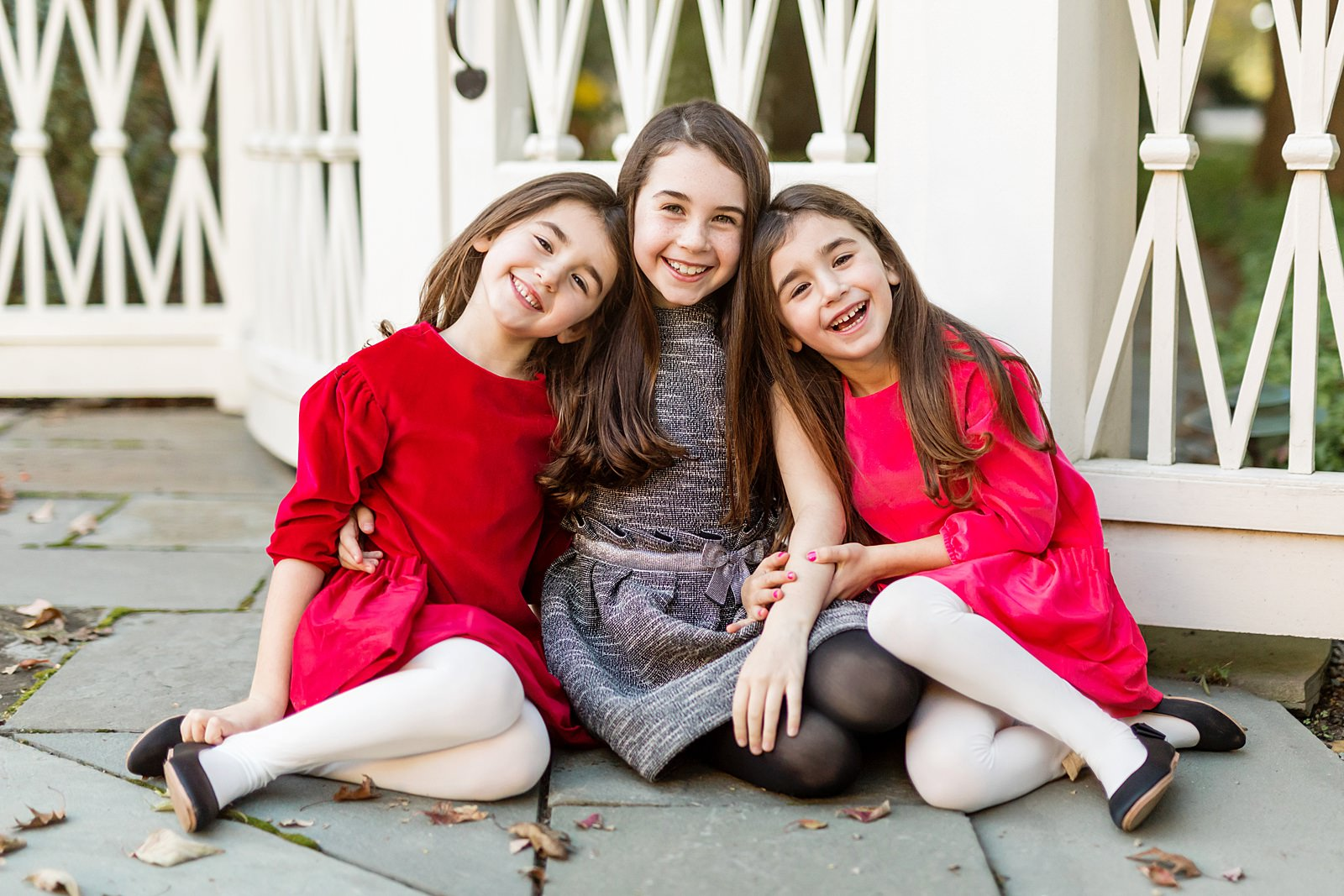 three sisters in holiday dresses