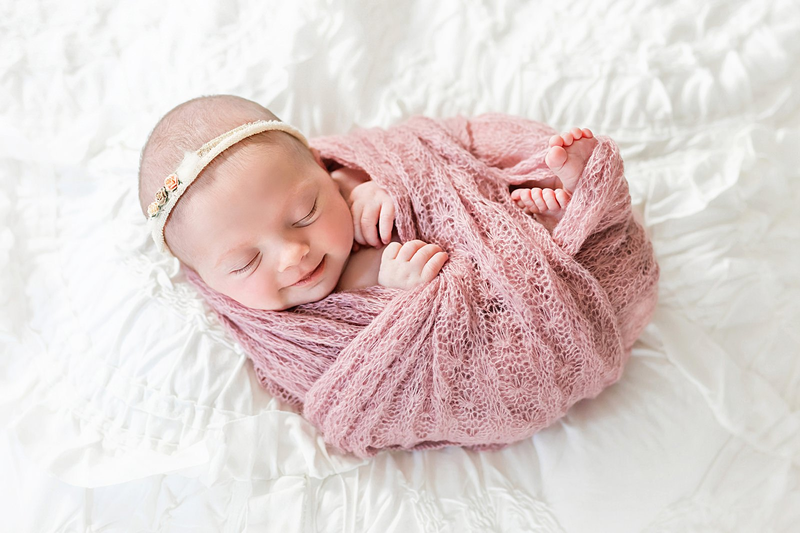 smiling newborn baby photo