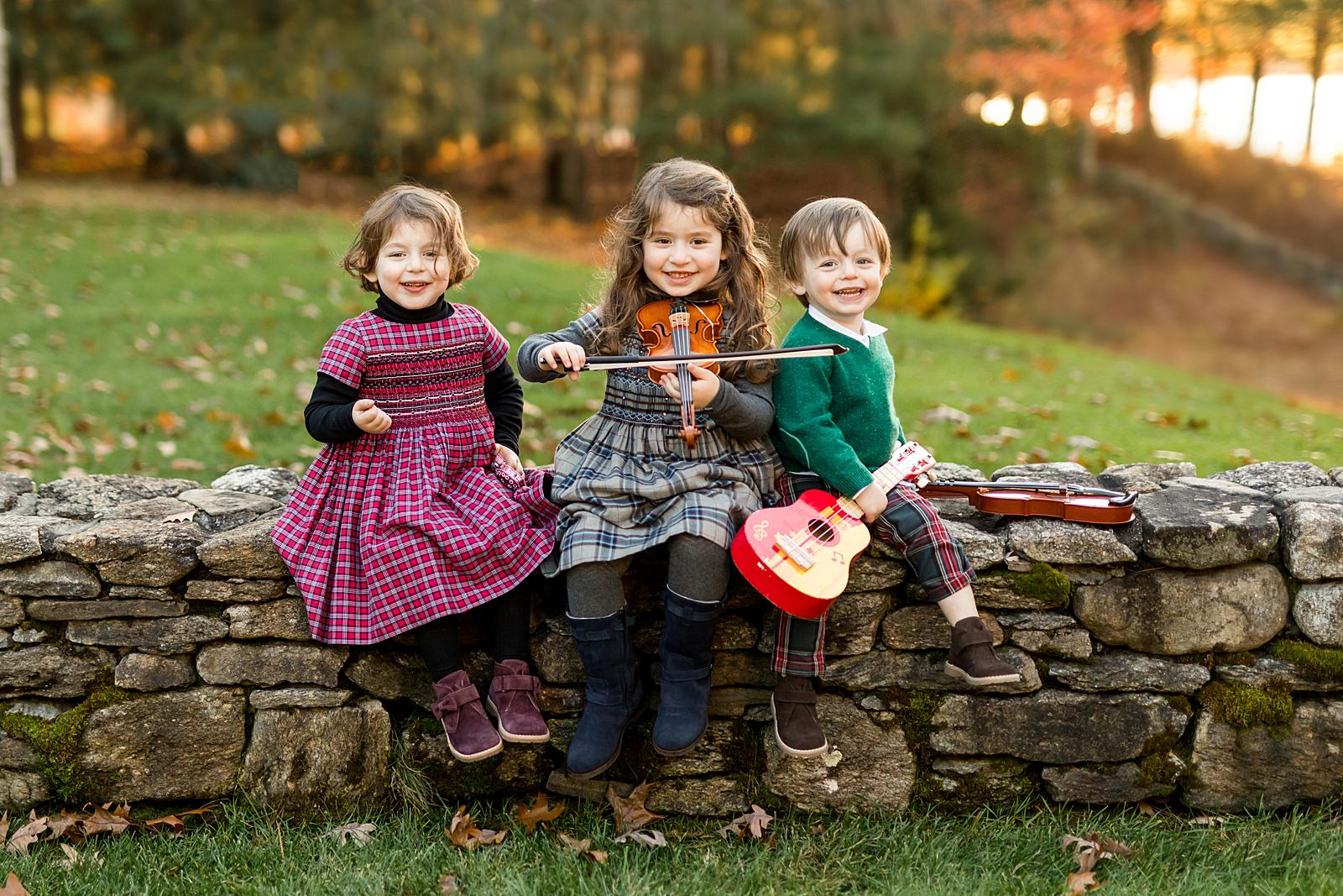 three children play musical instruments