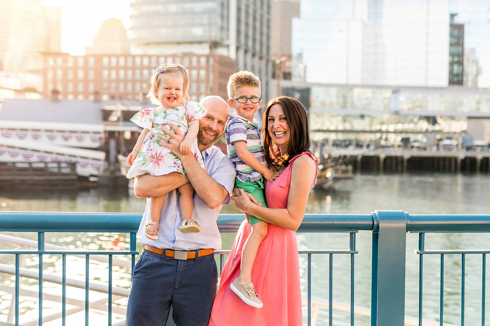 a boston family stands in front of boston skyline