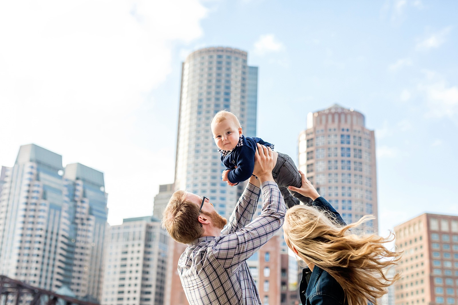baby flying high in front of boston skyline