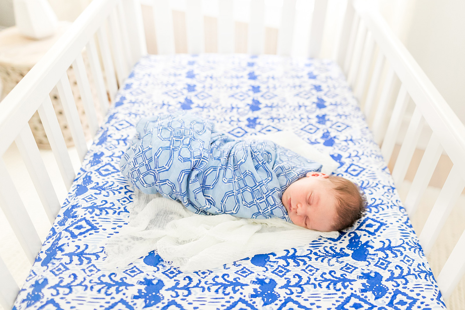 baby boy swaddled in crib in Boston