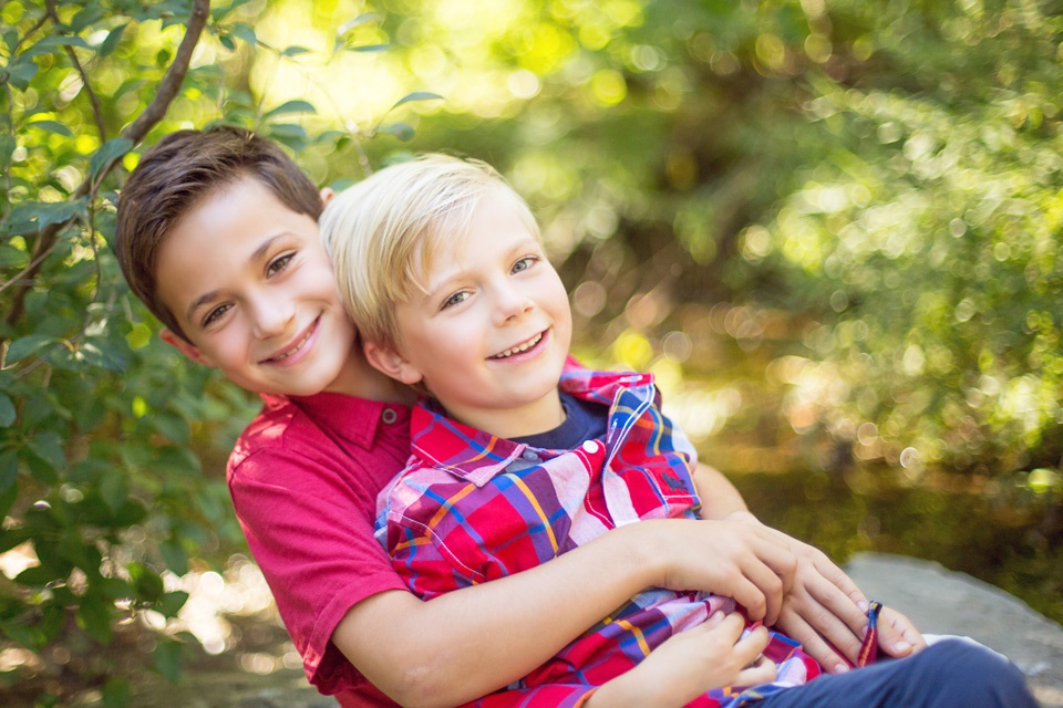 brothers hug at arnold arboretum for photo session