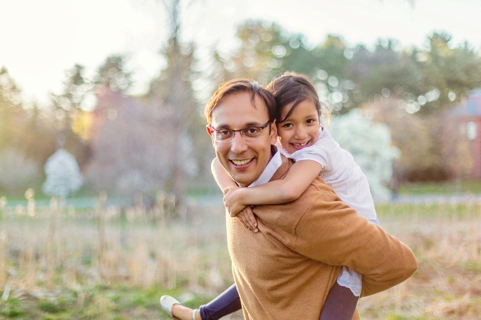 daddy/daughter piggyback ride at arnold arboretum.