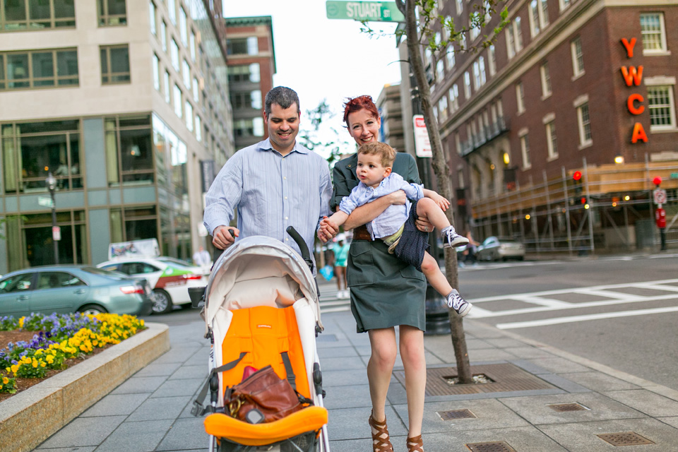A young family with a toddler walks down Clarendon Street in Back Bay, Boston.