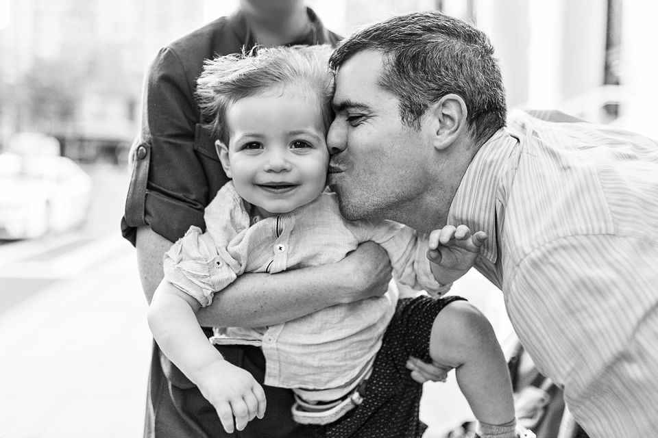 Dad kisses son on the cheek. Taken by Kate L Photography