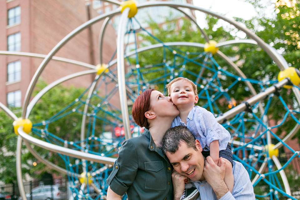 Family poses for a photo at frieda garcia park in back bay.