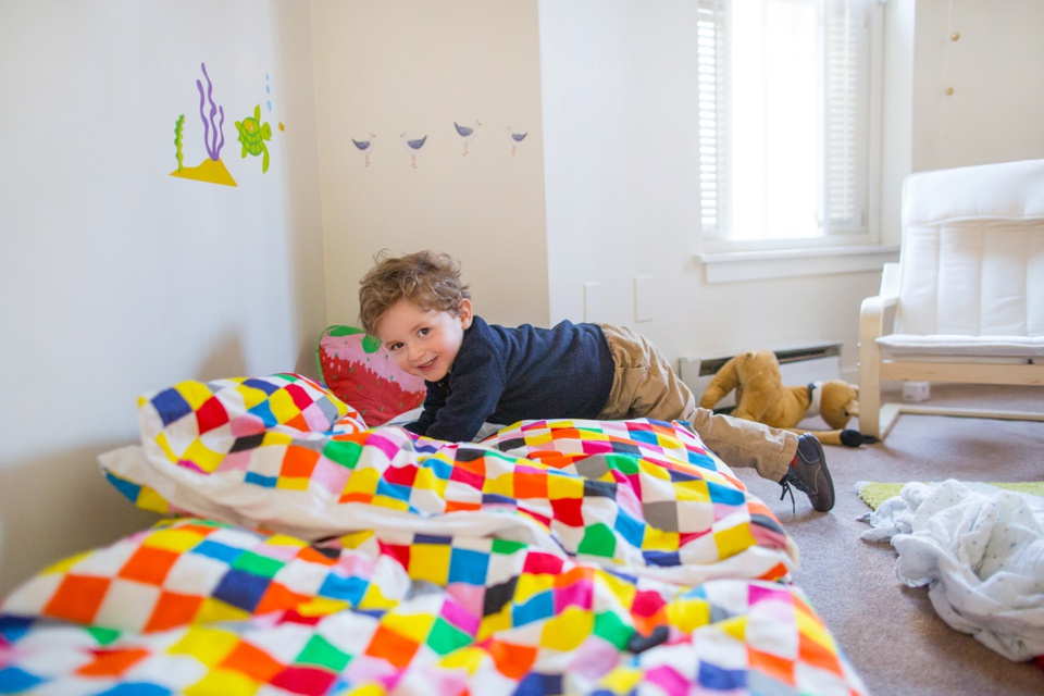 little boy plays in his room in boston south end condo