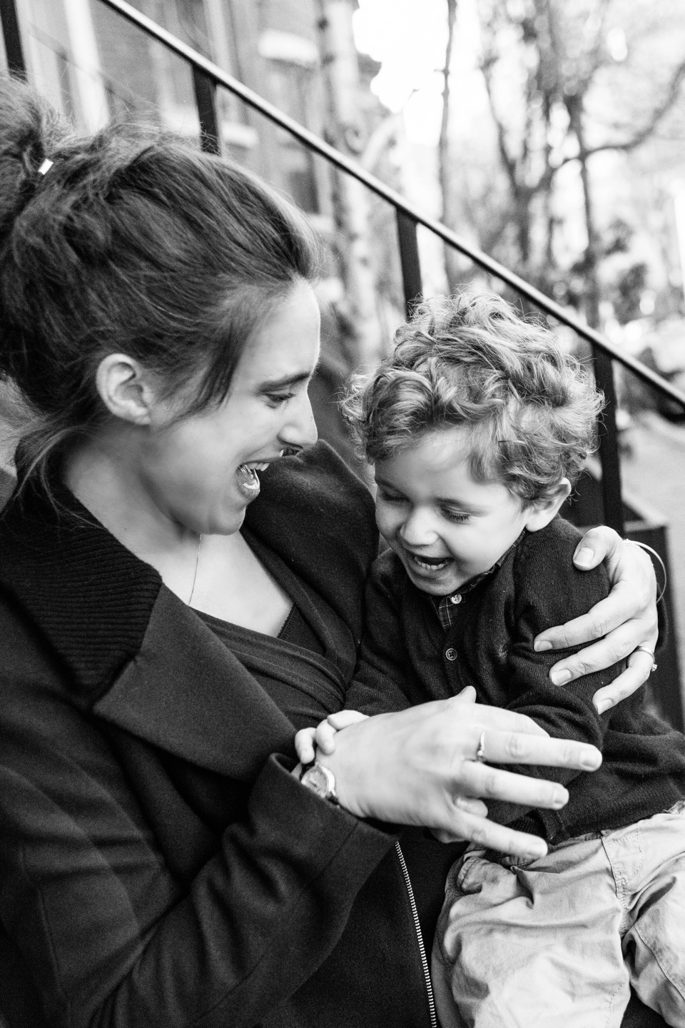 mom and son play on brownstone in south end.