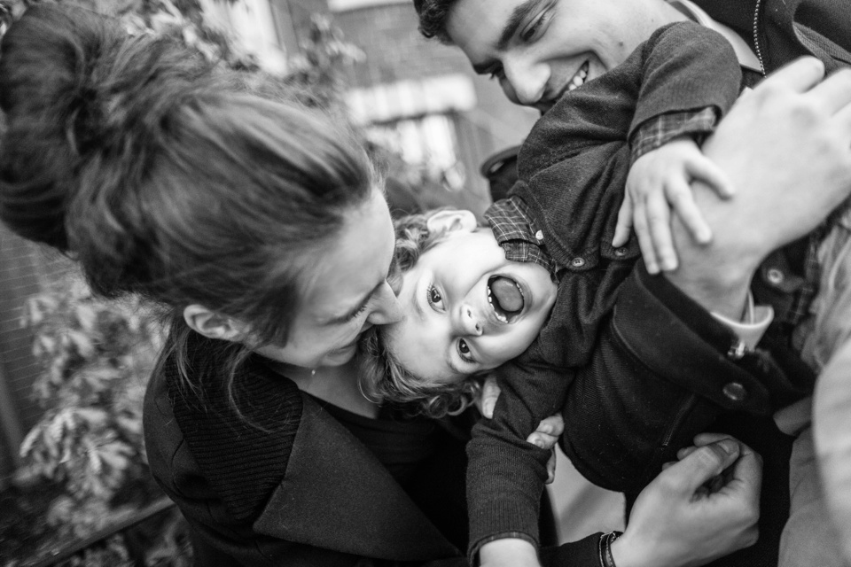 Mom, dad, and son work with a child photographer in Boston's South End neighborhood.