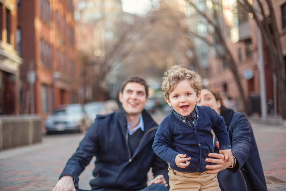 Family photographed outdoors by Boston family photographer Kate Lemmon.