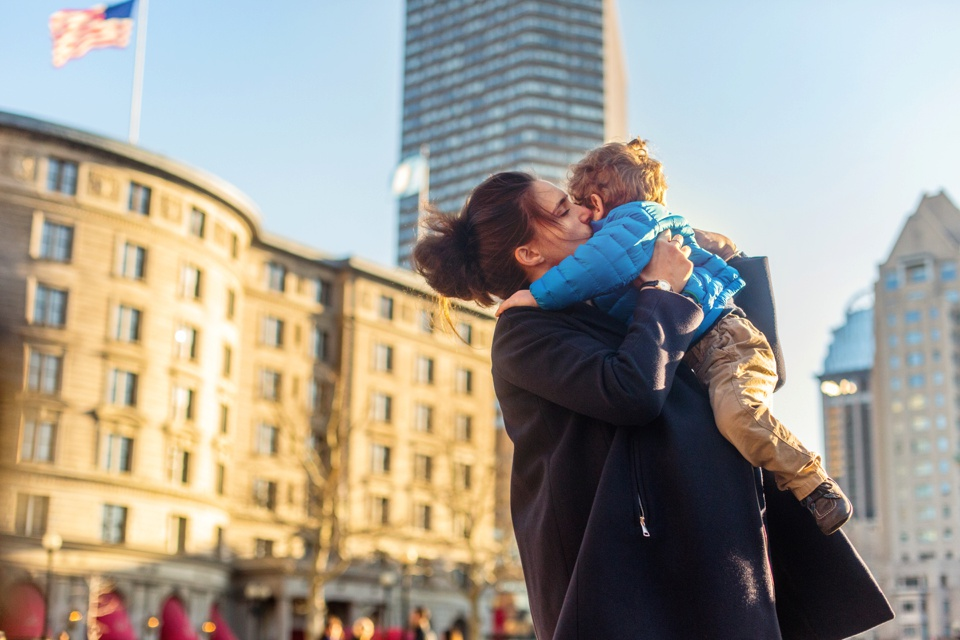 Mom and Son photographed in front of the Fairmont Copley Square. Maternity photos at 36 weeks pregnant.