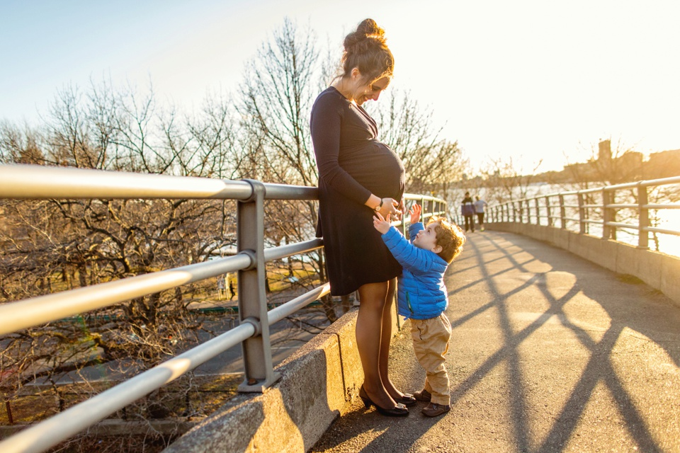 Mom takes maternity photos with natural light on the Charles River Esplanade.