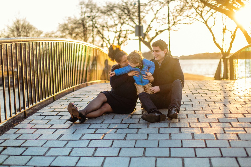 Family photographer works at the Charles River Esplanade.