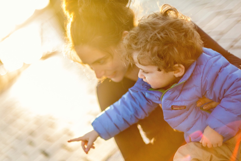 Family photographer uses natural light by the Charles River Esplanade.
