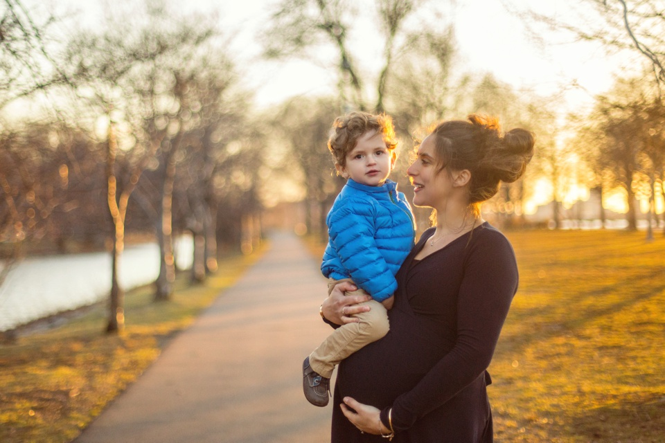 Maternity photos with mom and son, photographed by the Charles River Esplanade.
