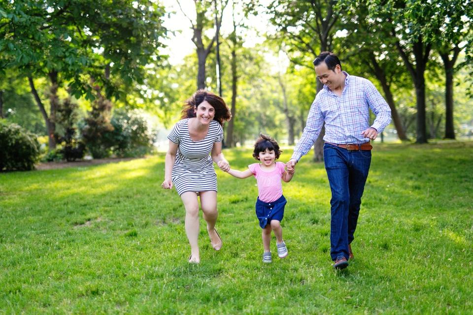 Family running toward camera in Boston.