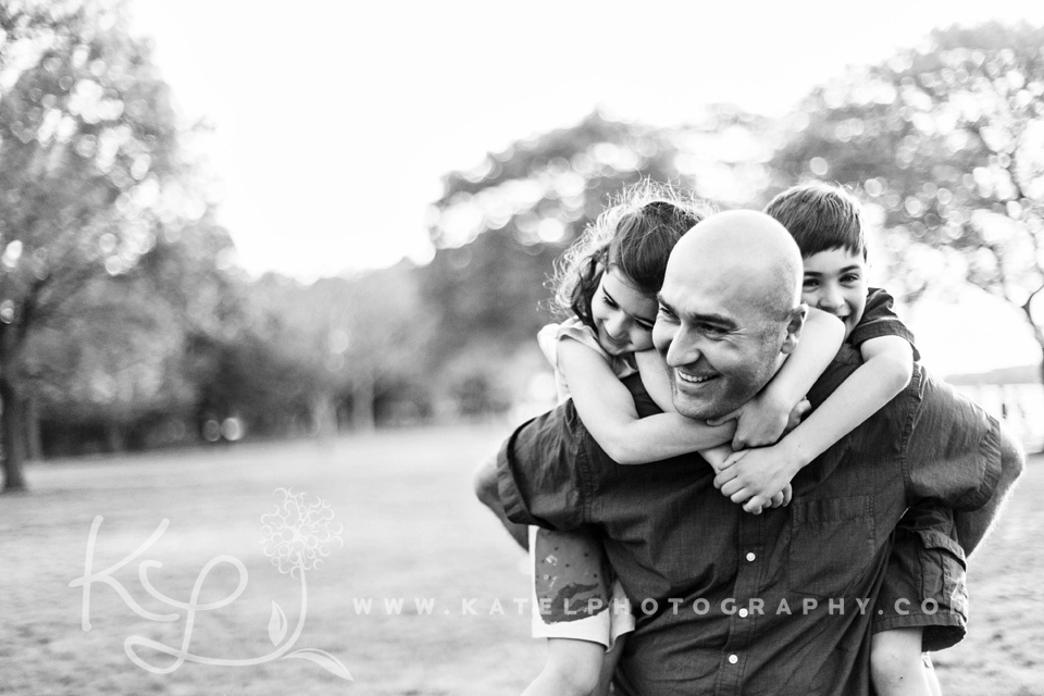 A Boston family photographer documents a Back Bay family hanging out on the Charles River Esplanade.