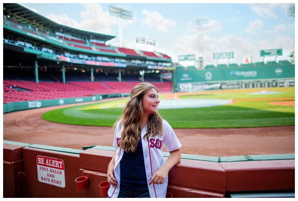 A high school senior portrait session photographed inside Boston's Fenway Park.