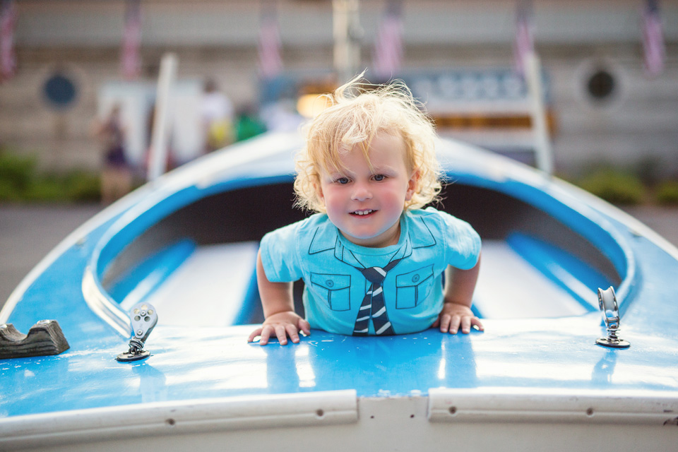 Boston child photographer Kate Lemmon documents a toddler at the community boating dock in Boston.