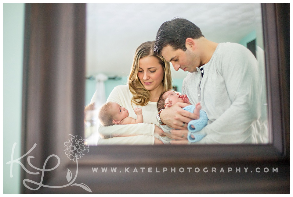 Lifestyle images of twin newborn babies, photographed at home using natural light, taken by Boston newborn photographer Kate Lemmon.